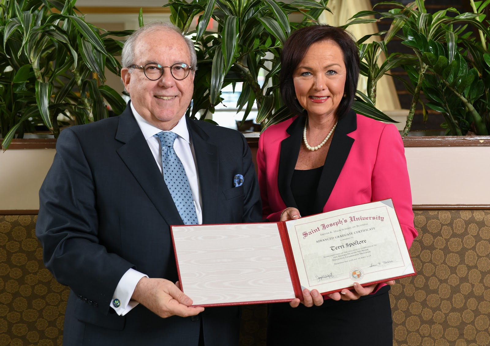 Spoltore receiving her certificate with Joseph A. DiAngelo '70, Ed.D., Dean of the Erivan K. Haub School of Business