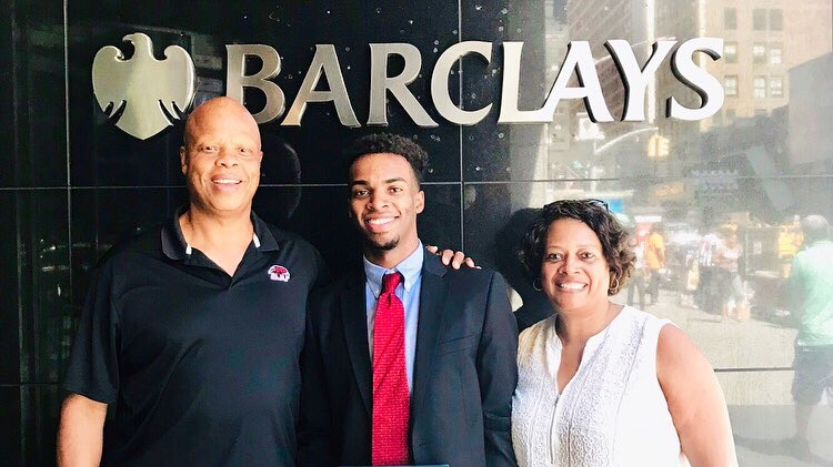 Smith '20 (center) outside the Barclays New York City office with his parents.