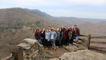 A group of students pose at the appalachian mountains